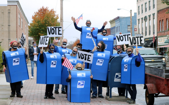 Mailboxes dance, sing, and deliver voting info in downtown Scranton on Oct. 31