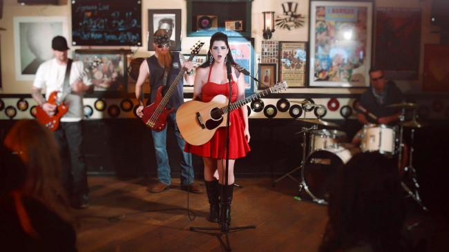 VIDEO PREMIERE: Resilient rocker Karen Bella takes a shot of 'Jack Honey' in debut music video